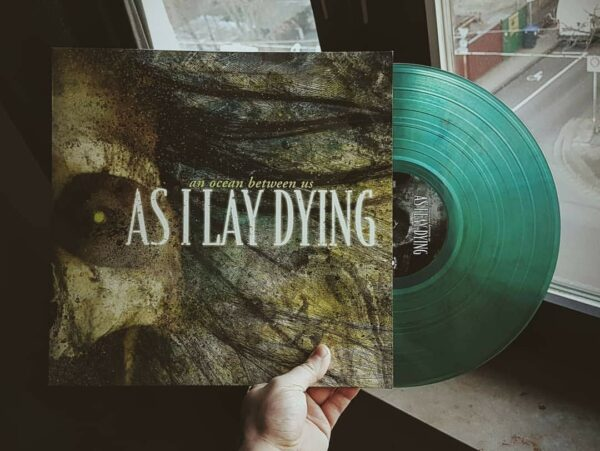 As I Lay Dying - An Ocean Between Us, Limited Clear Swamp Green Marbled Vinyl, 200 Copies